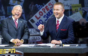 Hosts Lee Corso and Kirk Herbstreit share a laugh as they talk during ESPN's College GameDay broadcast at the University of Washington early Saturday morning.