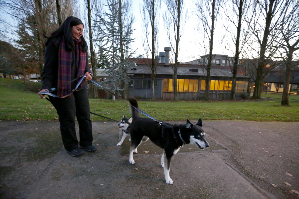 Kshama Sawant strolls with her dogs, Che, left, and Rosa. In her private life, Sawant follows the Seahawks, enjoys hosting dinner parties and is engaged to be married. (Ken Lambert/The Seattle Times)