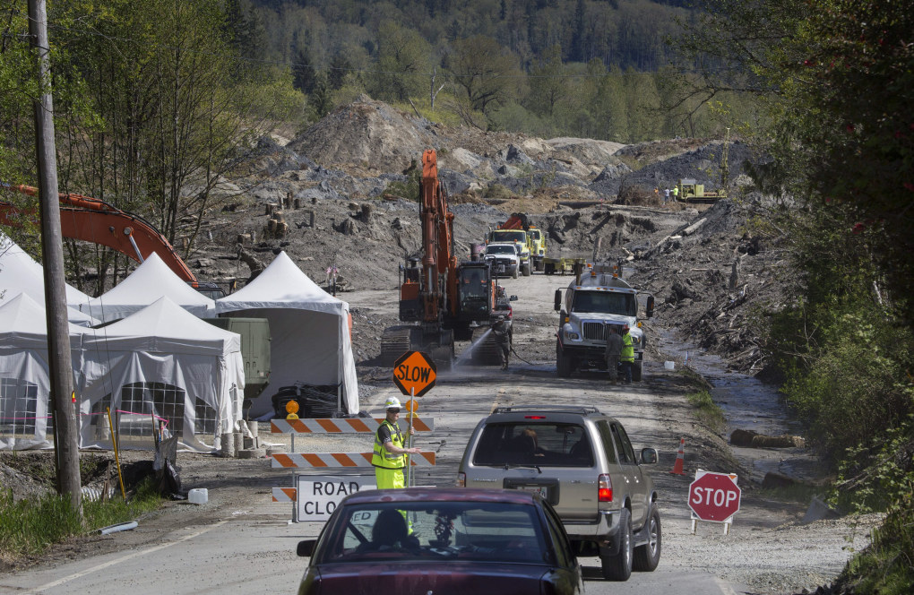Traffic is diverted to a primitive, one-lane road around the slide zone on March 29, 2014. (Ellen M. Banner / The Seattle Times)