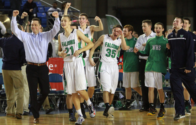 Woodinville's bench celebrates a close win over Kentwood, 58-57, in a 4A boys state quarterfinal game on Thursday in Tacoma. (Ken Lambert / The Seattle Times)