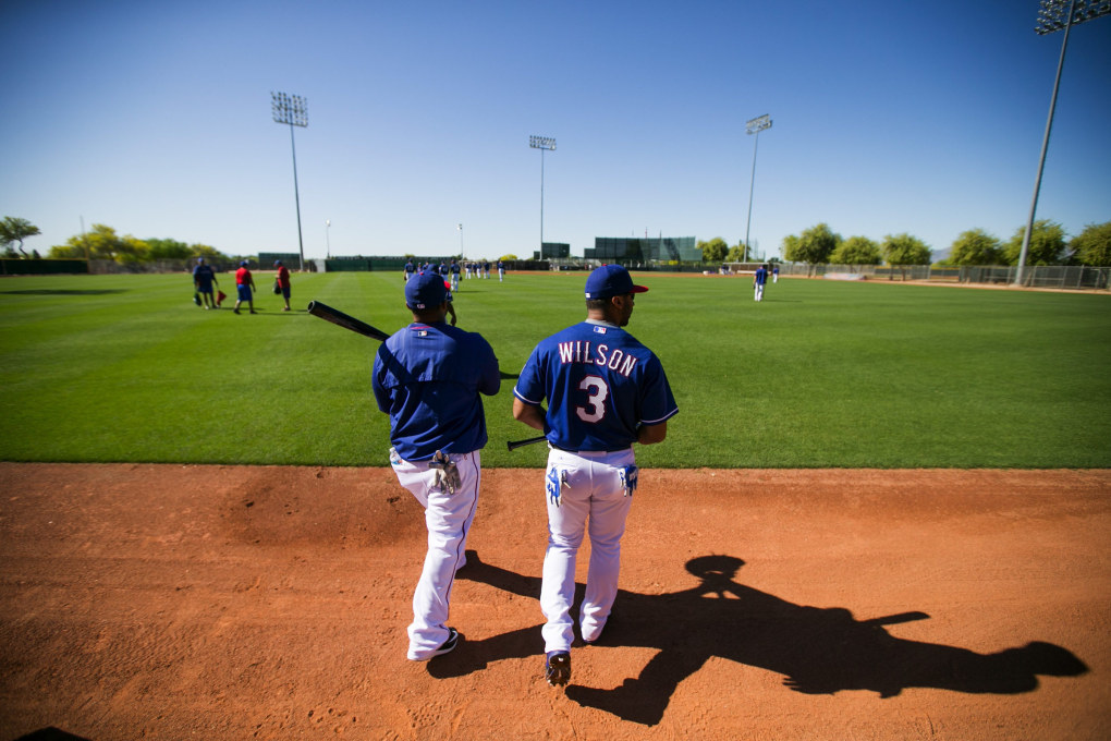 Seahawks quarterback Russell Wilson talks to Prince Fielder while walking out of the clubhouse at the Texas Rangers' Spring Training in Surprise, Arizona Saturday March 28, 2015. (Bettina Hansen / The Seattle Times)