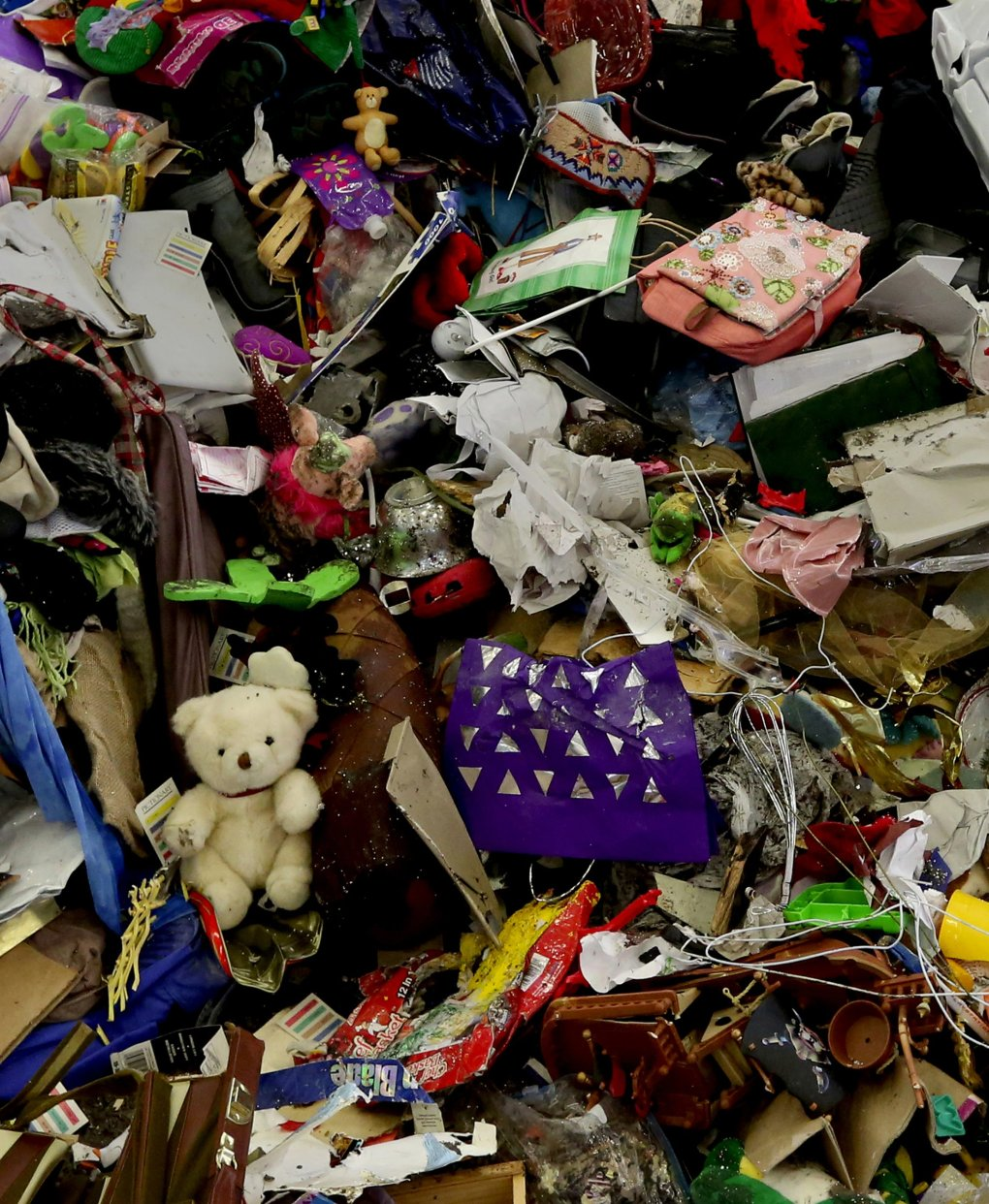 Once treasured, now discarded, a teddy bear is part of the refuse at Seattle's South Transfer Station awaiting shipment to a landfill in Eastern Oregon. (Alan Berner/The Seattle Times)