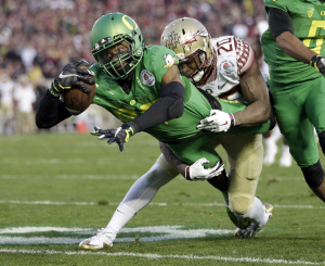 FILE – in this Jan. 1, 2015, file photo, Oregon wide receiver Darren Carrington, front, scores under pressure from Florida State defensive back Trey Marshall during the Rose Bowl NCAA college football playoff semifinal in Pasadena, Calif. (AP Photo/Jae C. Hong, File)