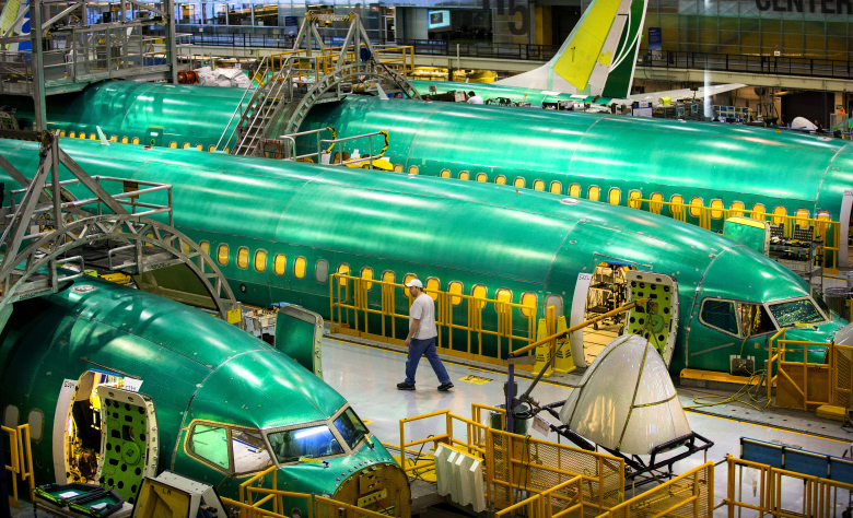 Systems installation at Boeing's Renton plant now takes place on six 737 fuselages at the same time. That will grow to nine fuselages later this year as production ramps up. These fuselage sections move on a rail system from one position to the next.  (Mike Siegel/The Seattle Times)