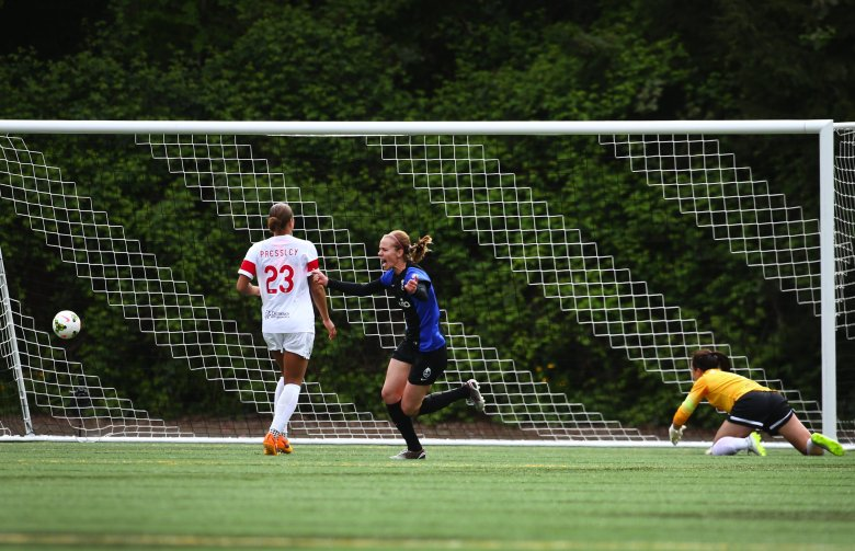 Seattle Reign FC forward Beverly Yanez turns to celebrate as she scores a goal against Western New York. (Lindsey Wasson/The Seattle Times)