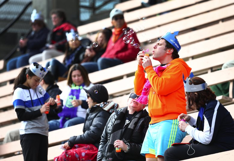 A Reign FC fan blows bubbles before the game before their season opener against the Western New York Flash at Memorial Stadium.  (Lindsey Wasson/The Seattle Times)
