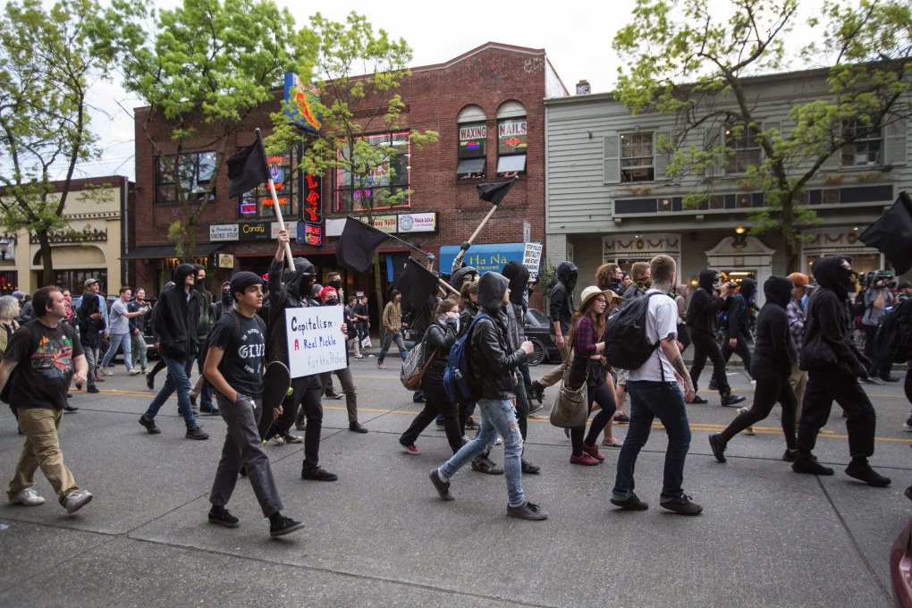 Marchers head north on Broadway through the heart of Capitol Hill. (Dean Rutz / The Seattle Times)