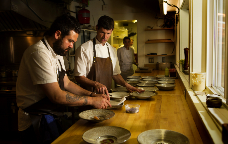 Daniel Patterson from San Francisco's Michelin-starred Coi, right, confers with Nick Green, the chef de cuisine at Willows Inn. Patterson was the guest chef at the Willows Inn on July 9 during the Grand GELINAZ! Shuffle.  (Ellen M. Banner/The Seattle Times)