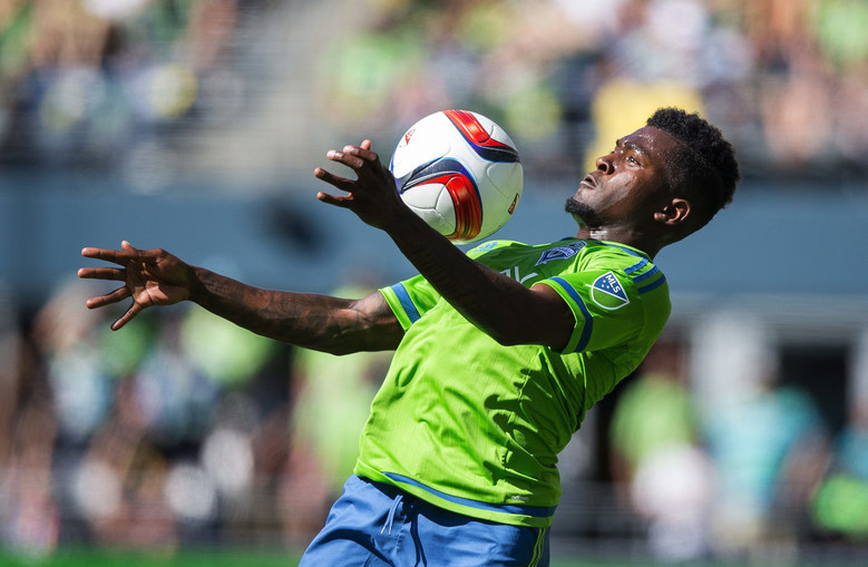 Seattle's Darwin Jones takes the downfield pass and sets up a play near the corner in the second half. (Dean Rutz / The Seattle Times)