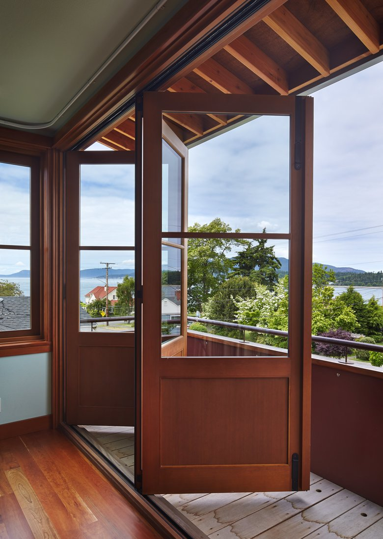 On the first floor, Hall turned views inward to the courtyard, but upstairs in the master suite they open wide to water views that include ferries off to Guemes and the San Juan Islands.  (Benjamin Benschneider/The Seattle Times)