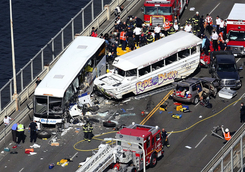 A Ride the Ducks tour vehicle collided with a bus on the Aurora Bridge. (Ken Lambert / The Seattle Times)