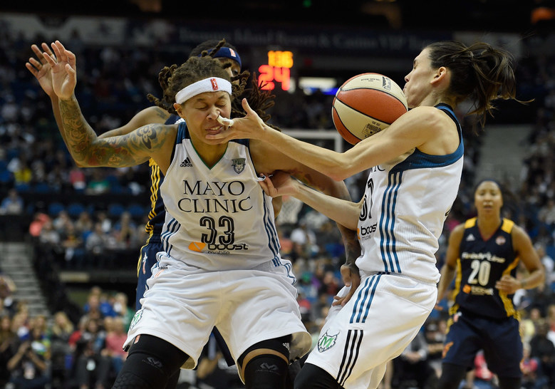Seimone Augustus #33 and Anna Cruz #51 of the Minnesota Lynx go after a loose ball during the fourth quarter in Game Two of the 2015 WNBA Finals against the Indiana Fever on October 6, 2015 at Target Center in Minneapolis, Minnesota. The Lynx defeated the Fever 77-71. (Photo by Hannah Foslien/Getty Images)