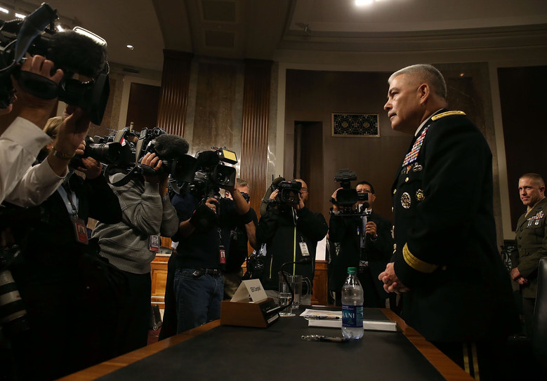 US Army Gen. John Campbell commander of the Resolute Support Mission and United States Force Afghanistan, prepares to testify  during a Senate Armed Services Committee hearing on Capitol Hill September 6, 2015 in Washington, DC. The committee questioned Campbell on the situation in Afghanistan and last weeks US airstrike on a hospital run by Doctors Without Borders that killed at least 22 people.  (Photo by Mark Wilson/Getty Images)