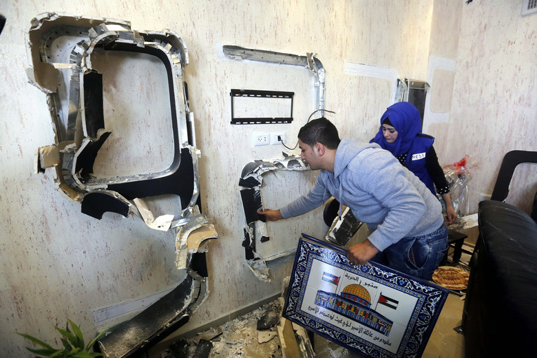 Palestinian journalists inspect the damage of their Al Hurria radio station in the West Bank city of Hebron, November 3, 2015. Israeli forces earlier on November 3 raided the radio station in the West Bank city of Hebron and ordered it shut down for six months, Palestinian officials said. Ayman Qawasmi, the director of the station, Minbar al-Hurriah 92.7 FM, said a large army unit marched into the station's office in the Palestinian-controlled section of Hebron and seized equipment before handing the staff an order closing it for six months. Israeli government officials had previously threatened to take legal action to shut down official Palestine TV and radio, which operate out of Ramallah, the de facto Palestinian capital, on incitement grounds.  EPA/ABED AL HASHLAMOUN