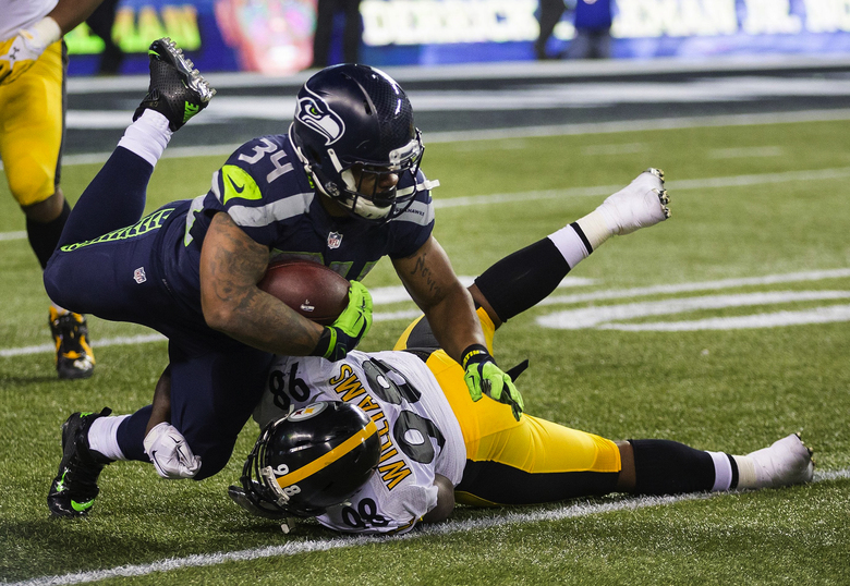 Thomas Rawls gets just enough yards to earn a first down, allowing Seattle to run out of the block against Pittsburgh. (Dean Rutz/The Seattle Times)
