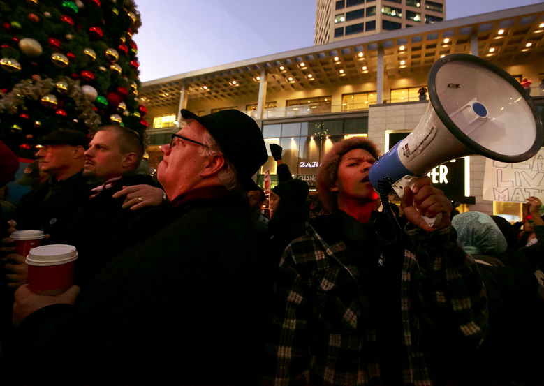 Black Lives Matters protesters demonstrate at the tree-lighting ceremony at Westlake Center in Seattle on  Friday,  (Erika Schultz / The Seattle Times.)