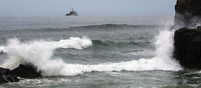 "Gazing out into the horizon from Ecola State Park, directly north of Cannon Beach, you can just make out ""Terrible Tilly,"" the Tillamook Rock lighthouse built in 1881 and deactivated, due to dangerous conditions, since 1957.  (Ellen M. Banner/The Seattle Times)"