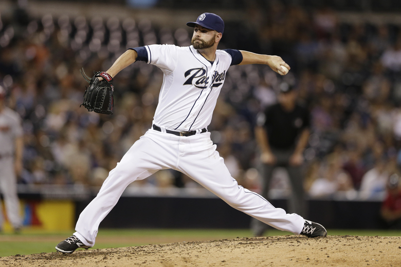 FILE – In this Sept. 25, 2015, file photo, San Diego Padres relief pitcher Marc Rzepczynski works against an Arizona Diamondbacks batter during the ninth inning of a baseball game, in San Diego. A person with knowledge of the deal says the San Diego Padres have traded first baseman Yonder Alonso and reliever Marc Rzepczynski to the Oakland A's for left-hander Drew Pomeranz and minor league pitcher Jose Torres, plus either a player to be named or cash. The person spoke with The Associated Press on Wednesday, Dec. 2, 2015,  on condition of anonymity because the trade hadn't been announced. (AP Photo/Gregory Bull, File)