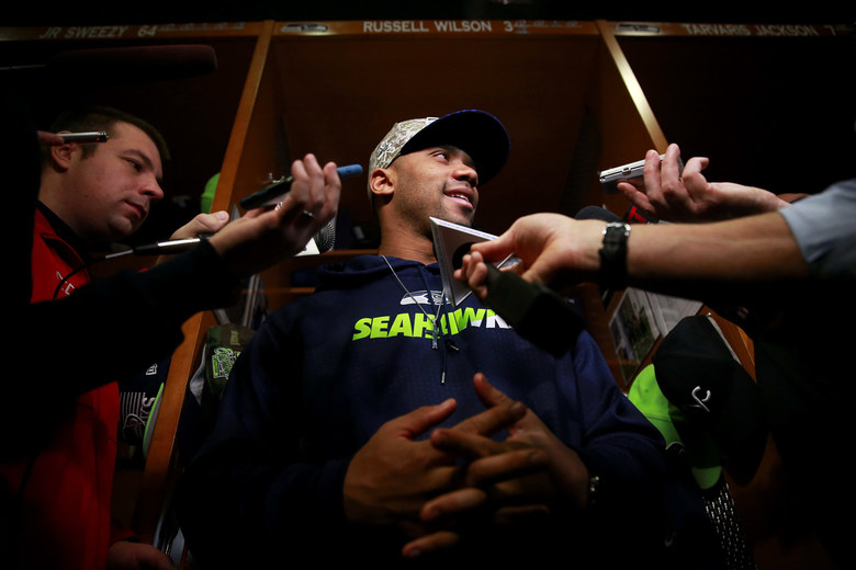 Russell Wilson talks to the media in the Seattle Seahawks locker room. (Erika Schultz / The Seattle Times)