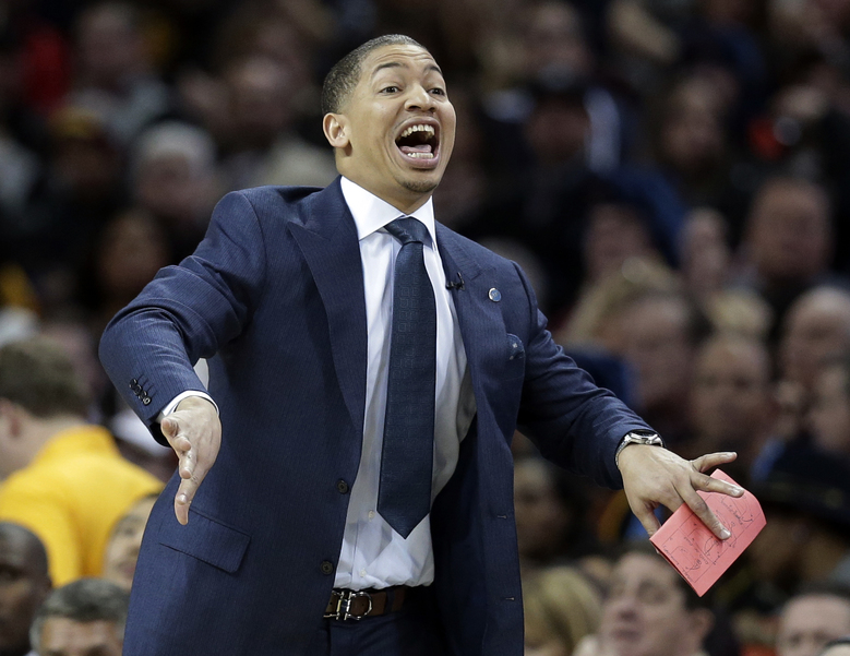 Cleveland Cavaliers coach Tyronn Lue shouts to players during Saturday's loss to Chicago in Cleveland. It was Lue's first game as coach of the team, which fired David Blatt. (Tony Dejak/AP)