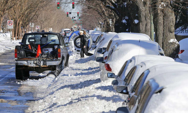 A tuber heads to a hill as area residents dig out from a massive snowstorm in Richmond, Va., Sunday, Jan. 24, 2016.   (AP Photo/Steve Helber)