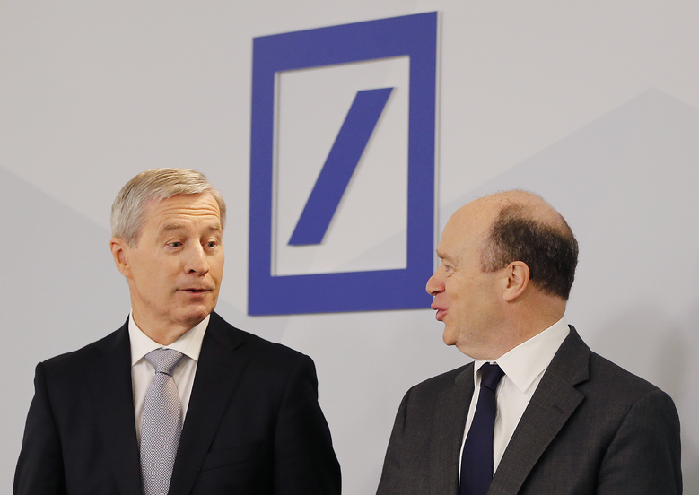 Co-CEOs of Deutsche Bank John Cryan, right, and Juergen Fitschen stand together prior to the annual press conference in Frankfurt, Germany, Thursday, Jan. 28, 2016. (AP Photo/Michael Probst)