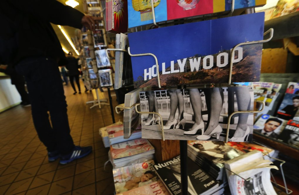 The newsstand also sells postcards and the stamps to mail them. (Alan Berner/The Seattle Times)