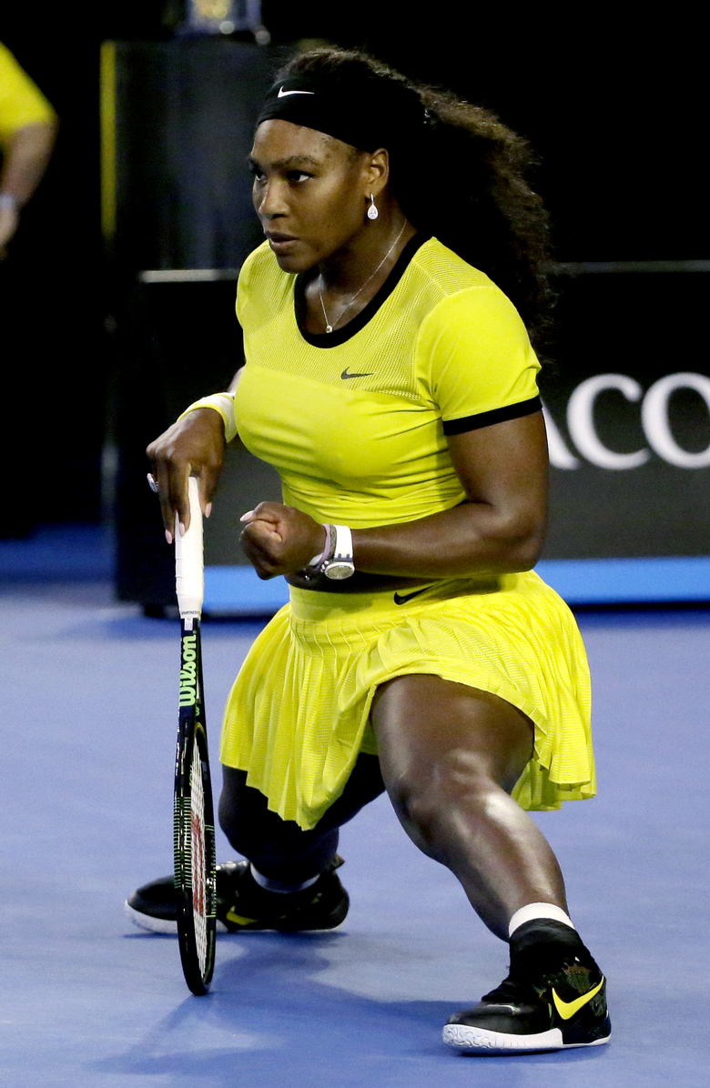 Serena Williams of the United States reacts after winning a point against Angelique Kerber of Germany during the women's singles final at the Australian Open tennis championships in Melbourne, Australia, Saturday, Jan. 30, 2016.(AP Photo/Aaron Favila)