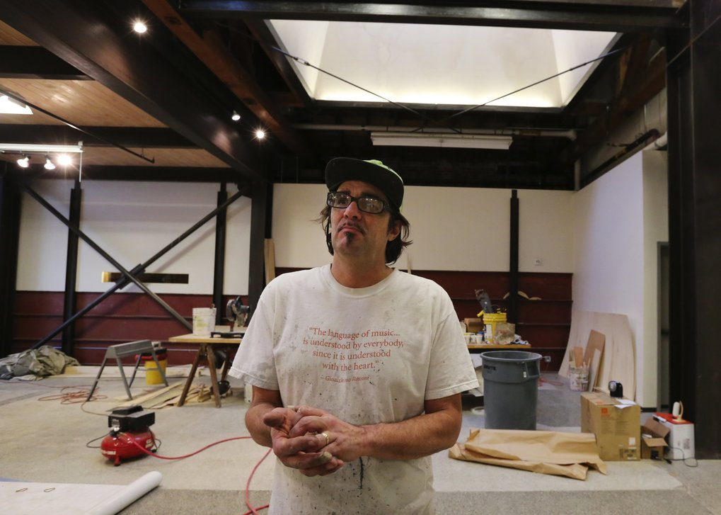 Artist Rick Araluce is a recent Guggenheim recipient and a lead scenic artist at Seattle Opera.  (Alan Berner/The Seattle Times)