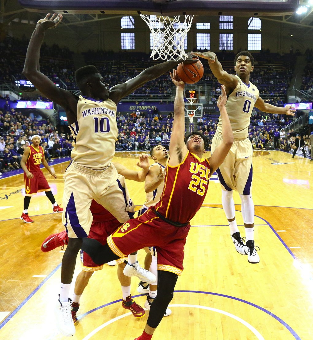 Washington's Malik Dime, left, and Marquese Chriss, right, team up to stop the shot of USC's Bennie Boatwright in the second half at Hec Edmundson Pavilion on Sunday, January 3, 2016, in Seattle, Wash. Washington won 87-85. (John Lok/The Seattle Times)