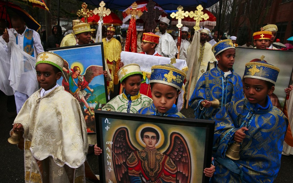 From left, Dawit Teshome, 8; Surafel Abiyu, 6; Yonatan Damtew, 8; Natty Seifu, 9; and Kirubel Abiyu, 8, walk in a procession during the celebration in Mount Baker on Saturday. (Erika Schultz/The Seattle Times)