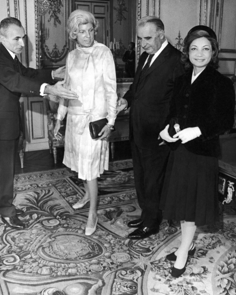 FILE – This Sept. 21, 1971 file photo shows, from left, Chief of Elysee Palace Protocol Jacques Senard, Mrs. Claude Pompidou, French President Georges Pompidou and Princess Ashraf Pahlavi at the Elysee Palace in Paris. Iranian Princess Ashraf Pahlavi, the twin sister of the country's deposed shah whose glamorous life epitomized the excesses of her brother's rule, has died after decades in exile. She was 96. Reza Pahlavi, a son of the shah, announced his aunt's death in a Facebook post on Thursday, Jan. 7, 2016.  (AP Photo/Jean Jacques Levy)