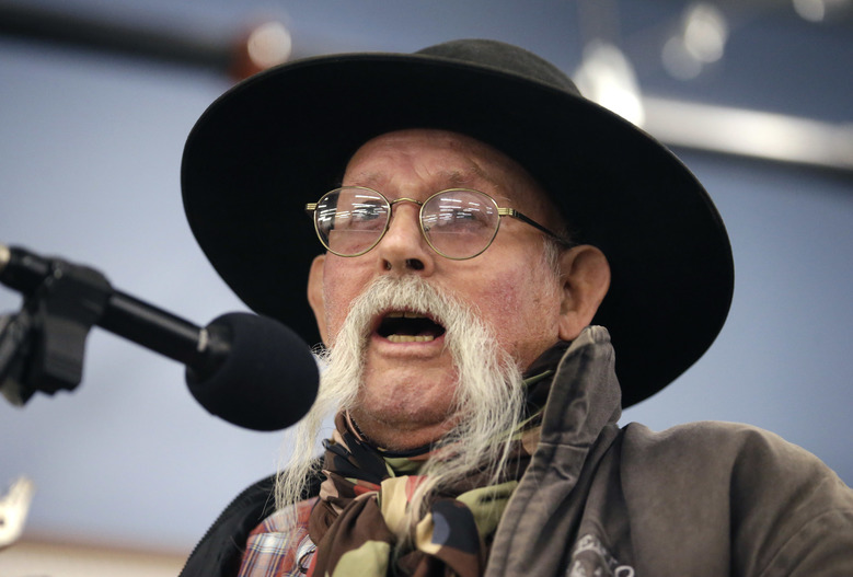 Merlin Rupp, 80, voices his opinion to Harney County Sheriff David Ward during a community meeting at the Harney County fairgrounds Wednesday, Jan. 6, 2016, in Burns, Ore. With the takeover entering its fourth day Wednesday, authorities had not removed the group of roughly 20 people from the Malheur National Wildlife Refuge in eastern Oregon's high desert country. (AP Photo/Rick Bowmer)