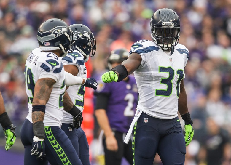 Kam Chancellor, right, celebrates a hit with his teammates. Chancellor would leave the game a short while later with an injury. The Seattle Seahawks played the Baltimore Ravens Sunday, December 13, 2015 at M&T Bank Stadium in Baltimore, MD.  (Dean Rutz/The Seattle Times)