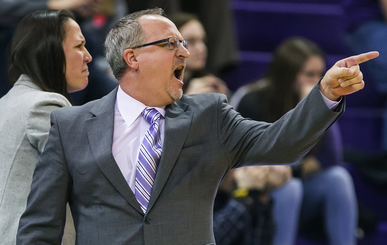 Washington coach Mike Neighbors argues a foul in the fourth quarter of Sunday's game against Oregon. The Huskies were outscored 35-19 in the fourth quarter. (Bettina Hansen/The Seattle Times)