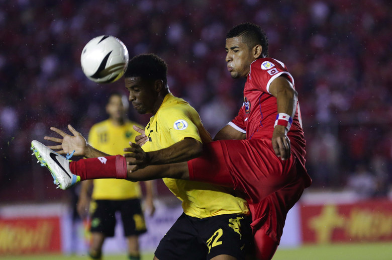 Panama's Roberto Chen, right, and Jamaica's Garath McCleary fight for the ball during a 2014 World Cup qualifying soccer match  Sept. 6, 2013, in Panama City. (Arnulfo Franco / AP)