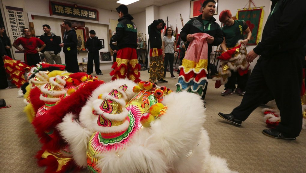 Mak Fai Kung Fu Club lion dancers get ready to take to the streets for the Chinese New Year celebration, Saturday.  (Alan Berner / The Seattle Times)