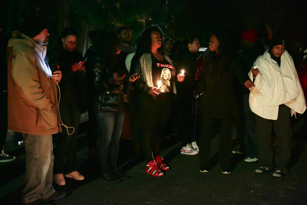 A crowd of friends and family gather for a candlelight vigil for Che Andre Taylor. (Erika Schultz / The Seattle Times)