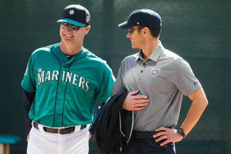 Mariners manager Scott Servais and general manager Jerry Dipoto are a big contrast to the previous regime. (Bettina Hansen / The Seattle Times)