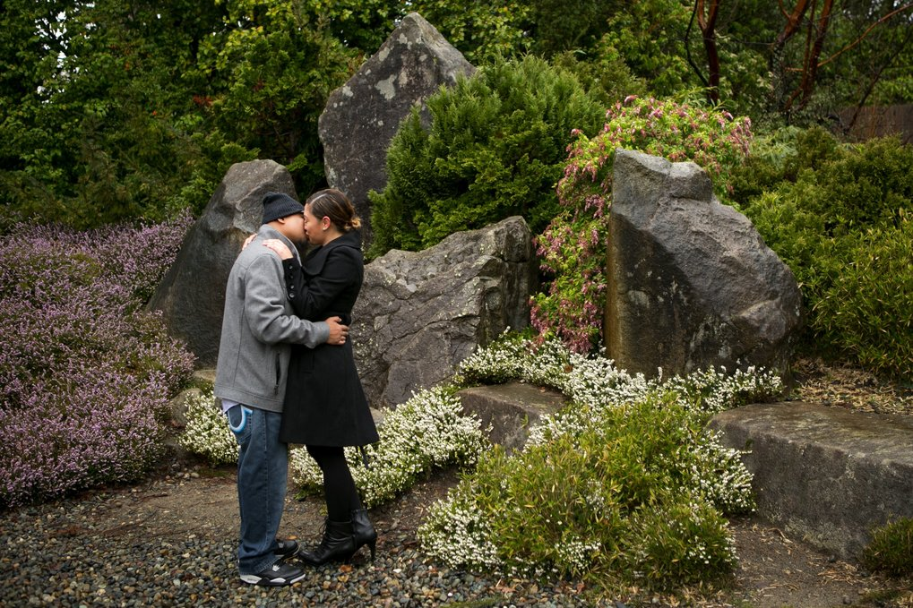 Chris Salazar gives his girlfriend, Maricela Ramirez, a kiss for the camera they've set up with a self-timer at the Kubota Garden in Seattle on Sunday. The two are visiting from Los Angeles, celebrating their first Valentine's Day together.  (Bettina Hansen/The Seattle Times)