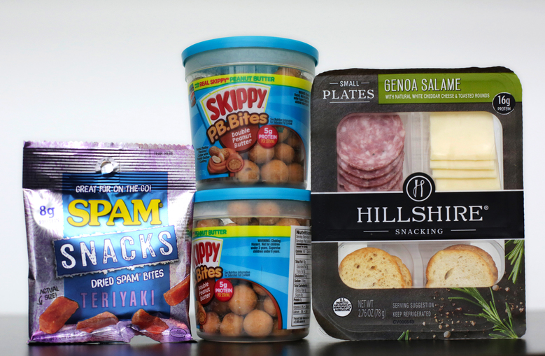 Spam Snacks, left, Skippy P.B. Bites, center, and Hillshire Genoa Salami with cheese and crackers are companies' response as grazing upends the way we eat. (Mark Lennihan/AP)