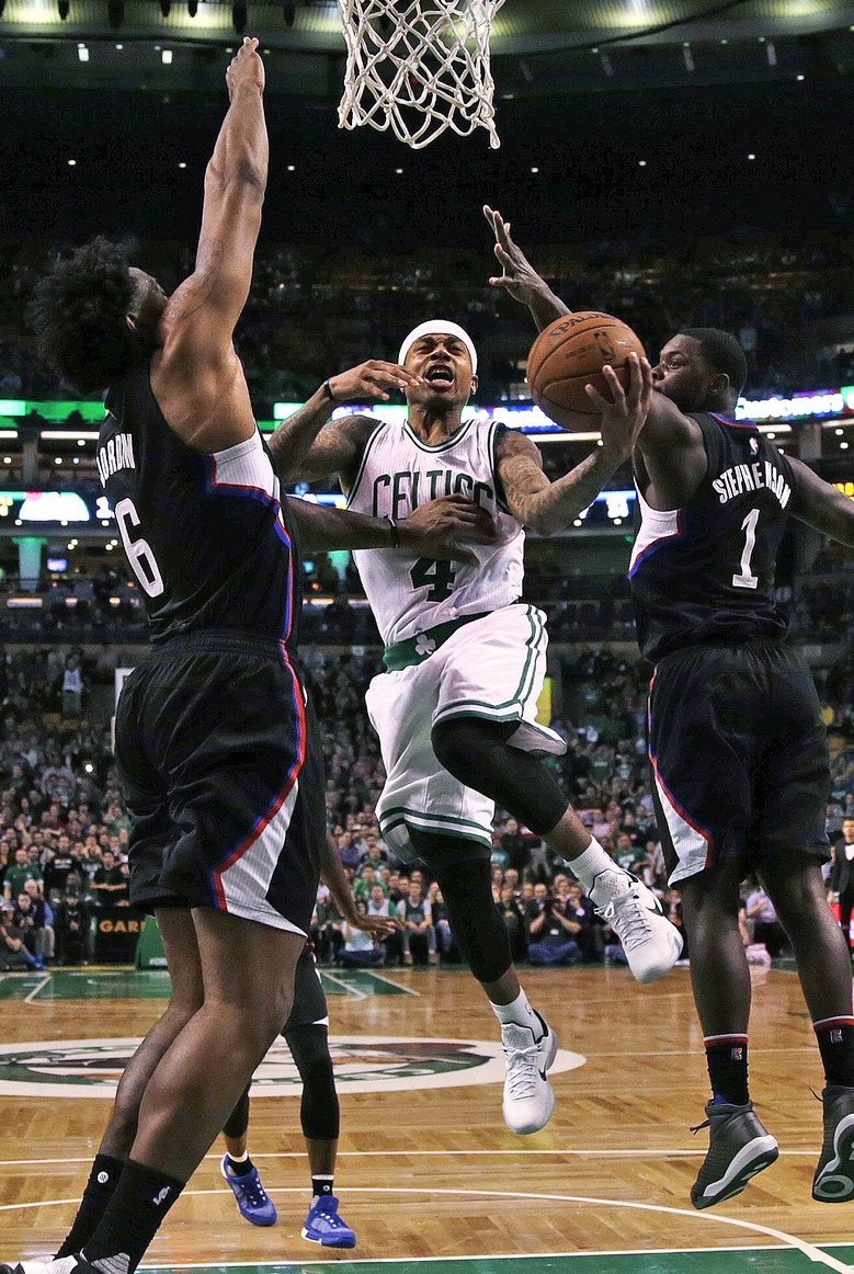 "Celtics guard Isaiah Thomas drives between the Clippers' Lance Stephenson, right, and center DeAndre Jordan. ""It's not even the talent that just makes him who he is. It's his drive,"" said former Kings teammate DeMarcus Cousins. (Charles Krupa/AP)"
