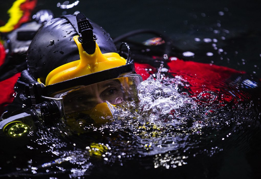Senior aquarist Chris Van Damme waits in the waters at the top of the Window on Washington Waters tank before a dive with an octopus.  (Lindsey Wasson/The Seattle Times)