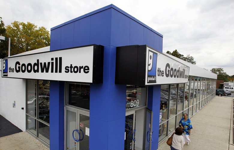 Shoppers go into a Goodwill store in Paramus, N.J. (Mel Evans/The Associated Press, file)