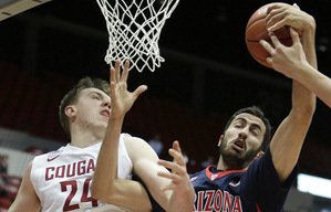 Washington State's Josh Hawkinson (24) and Arizona's Mark Tollefsen (23) go after a rebound during the first half of an NCAA college basketball game, Wednesday, Feb. (24) and Arizona's Mark Tollefsen (23) go after a rebound during the first half of an NCAA college basketball game, Wednesday, Feb. 3, 2016, in Pullman, Wash. (AP Photo/Young Kwak)