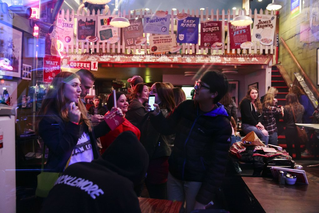 Fans wait before Macklemore and Ryan Lewis visit Easy Street Records in Seattle on Friday.  (Erika Schultz/The Seattle Times)