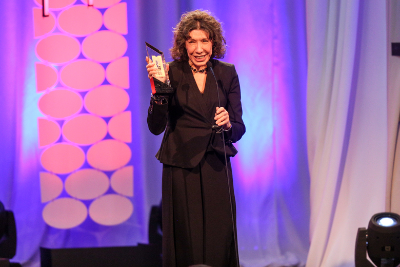 """Lily Tomlin accepts the award for Best Actress for """"Grandma"""" at the 15th Annual Movies for Grownups Awards at the Beverly Wilshire Hotel on Monday, Feb. 8, 2016, in Beverly Hills, Calif. (Photo by Rich Fury/Invision/AP)"""