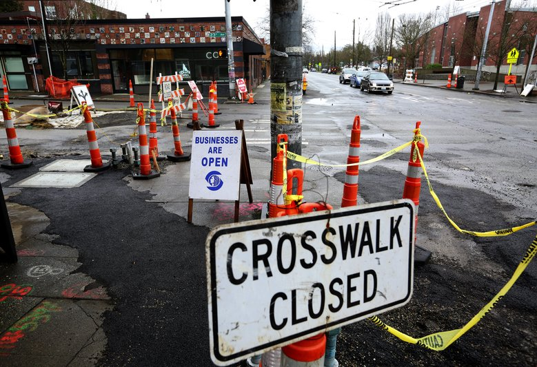 Small businesses along 23rd Ave. at Cherry St. are upset with the city over a massive construction project, Tues., Jan. 26, 2016, in Seattle's Central District. (Ken Lambert/The Seattle Times)