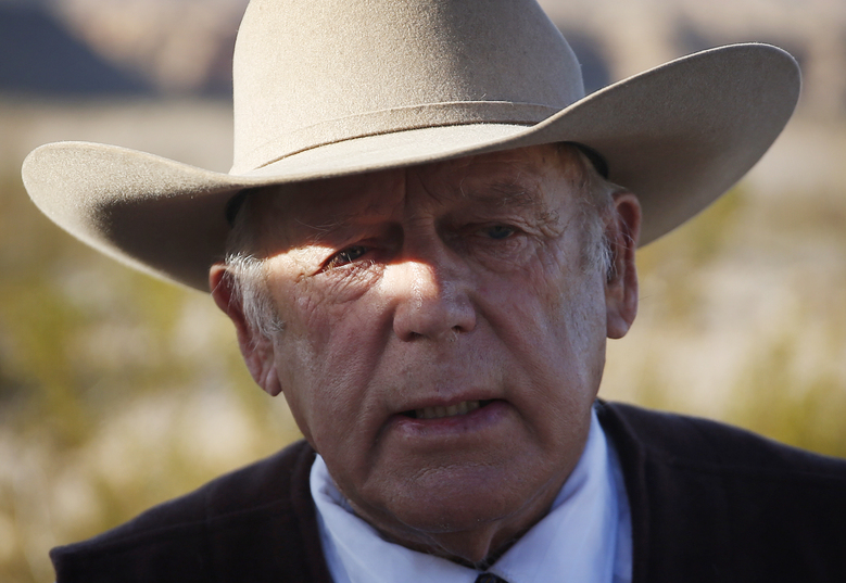FILE – In this Jan. 27, 2016, file photo, rancher Cliven Bundy stands along the road near his ranch in Bunkerville, Nev. Bundy, the father of the jailed leader of the Oregon refuge occupation, and who was the center of a standoff with federal officials in Nevada in 2014, was arrested in Portland on Wednesday, Feb. 10,, the FBI said Thursday, Feb. 11, 2016. (AP Photo/John Locher, File)