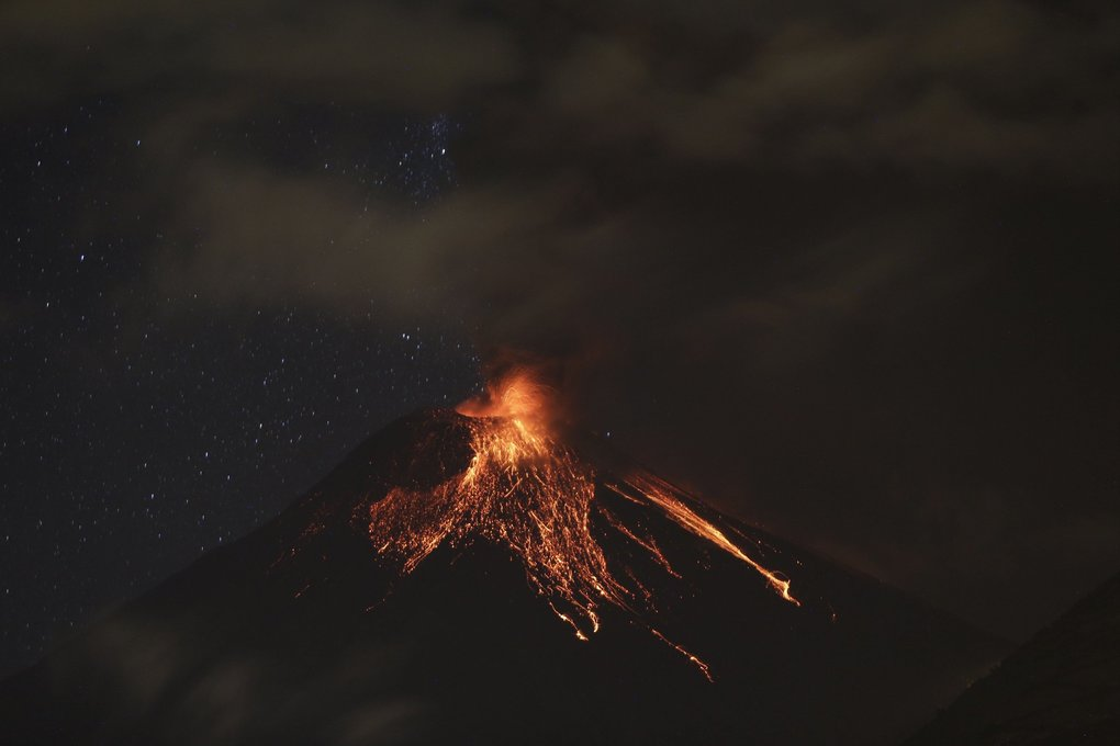 Incandescent lava bombs are ejected to the upper slopes of the volcano Tungurahua during an eruption as seen from Guadalupe, Ecuador, late Saturday, March 5, 2016.Tungurahua is 16,480 feet (5,023 meters) high and has been active since 1999.(AP Photo/Dolores Ochoa)